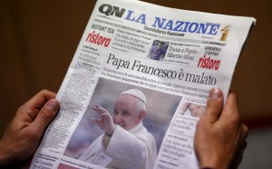 "A man reads the Italian newspaper ""Quotidiano Nazionale"" in Rome"
